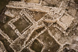 Archaeological ancient ruins of ancient buildings in Crimea, aerial top down view