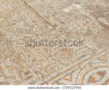 Archaeological remains with decorative tile floors and frescoes paintings in a hillside house on the slopes of the ancient city ruins of Ephesus, Turkey near Selcuk.