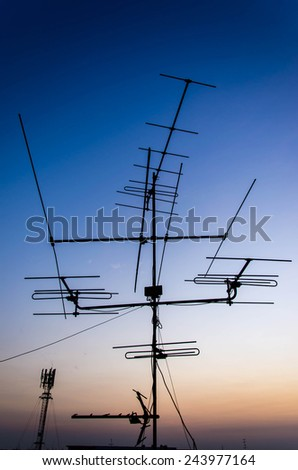 Archaic outdoor antennas silhouette at sunset