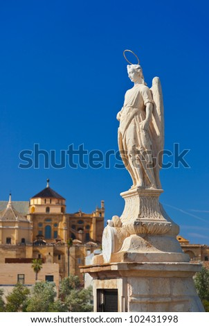 Archangel Raphael statue on bridge at Cordoba Spain - nature and architecture background