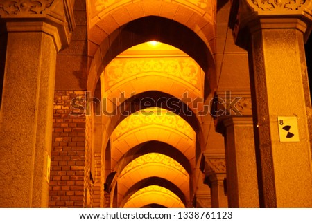 Arched Corridor at a beautiful Cathedral in Eastern Europe night. #1338761123