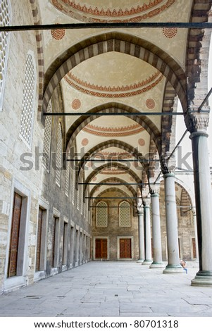 Arched courtyard corridor of the Blue Mosque ( Turkish: Sultan Ahmet Camii) in Istanbul, Turkey
