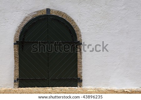 Arched doorway in green of a Cape Dutch homestead in Constantia, Cape Town, South Africa