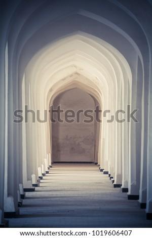 Arched hallway perspective at Mir-i-Arab medressa in Bukhara, Uzbekisan. #1019606407