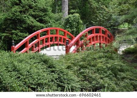 arched red japanese garden bridge 696602461
