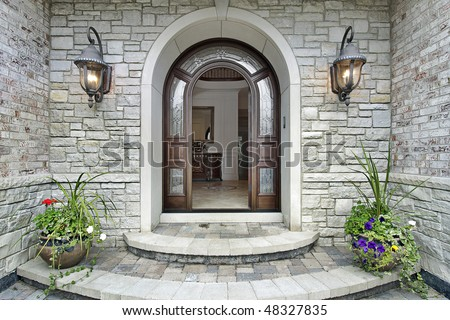 Arched stone entry of luxury suburban home
