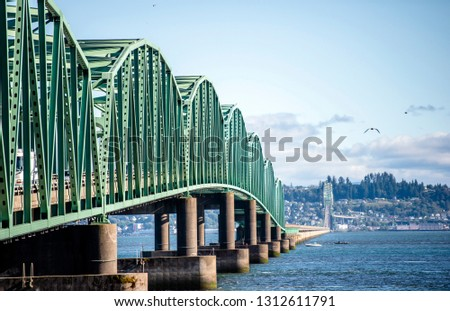Arched truss drawbridge over the Columbia River mouth with arch sections with lift towers for lifting the bridge section for the passage of vessels connect Oregon and Washington in Astoria #1312611791