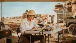 Archeological Digging Site: Great Female Archaeologist Doing Cultural Research, Discovers Ancient Civilization Historical Artifacts, Fossil Remains at Excavation Site, Study it Under Microscope