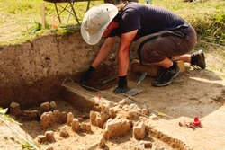 Archeological tools, Archeologist working on site, close-up, hand and tool.
