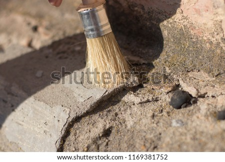 archeology female hand holds a tassel excavation of rare materials treasure hunt and archeology find rare  resources. Ideal for archeology news