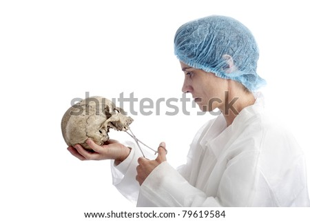 archeology or criminology: mature woman with skull. isolated on white background