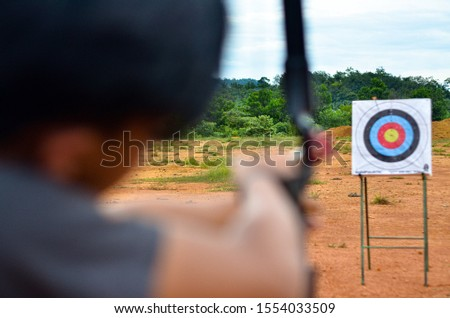Archer aiming on the target #1554033509