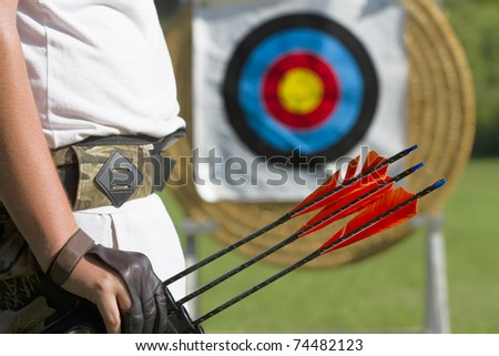 archer in front of a archery target