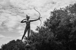 Archer statue with bird outdoors