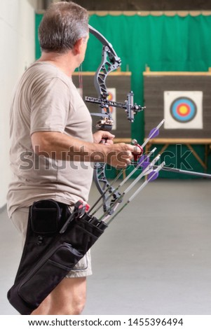 Archer Training With The Bow. Shooting the target in the background . #1455396494