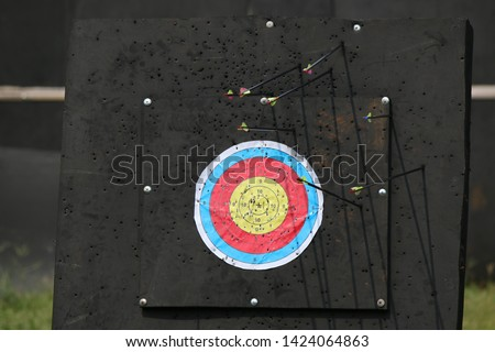 archers are aiming at the bulls eye target #1424064863