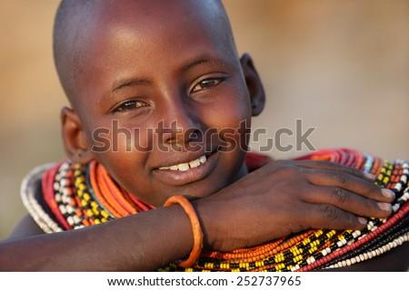 ARCHERS POST - KENYA - JANUARY 16, 2015: Unidentified young Samburu girl  with ochre on January 16, 2015 in Archers Post, Kenya.