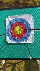Archery is a good sport, there is an archery boy whose shot is on the archery board with a pretty good shot.
