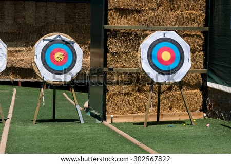Archery shooting target standing on the grass field