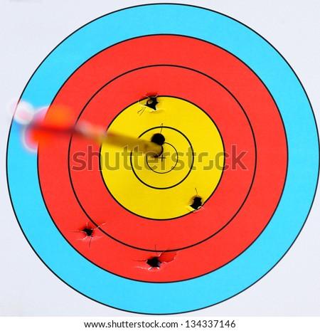 Archery target with arrow in the bulls-eye