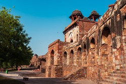 Arches made with red sandstone at a popular travel destination in Delhi, India. Amphitheatre at a castle in an old fort also known as Purana Qila or Quila.