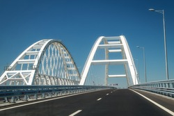 Arches of the Crimean bridge connecting the banks of the Kerch Strait: Taman and Kerch, Crimea. Russia