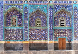 Arches with mosaics at the entrance to Shrine Ensemble, mausoleum and khaneghah of Sheikh Safi al-din, Ardabil, Iran. Inscription at the wall - text from the Quran. UNESCO world heritage site