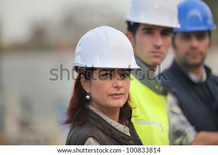 Architect and builders on site