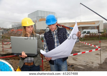 Architect and engineer on construction site