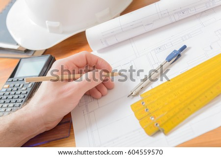 Architect at work. Construction plans, blueprint, measure, ruler and drawing tools  #604559570