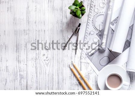 Architect at work. Drawing and tools on light wooden desk top view copyspace #697552141