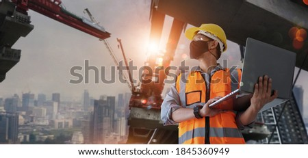 Architect,civil engineer holding laptop inspect and oversee infrastructure progress and security of city construction project. Industrial innovative technology and global construction solution concept