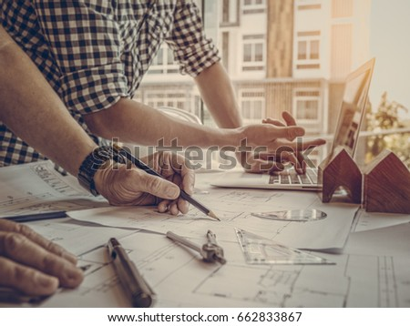 Architect concept, Architects working with blueprints in the office, Vintage Effect, Soft focus #662833867