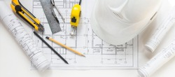 architect design working drawing sketch plans blueprints and making architectural construction model in architect studio,flat lay long banner
