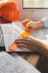 architect design working drawing sketch plans blueprints and making architectural construction model in home