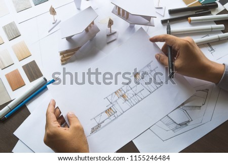 architect design working drawing sketch plans blueprints and making architectural construction model in architect studio #1155246484