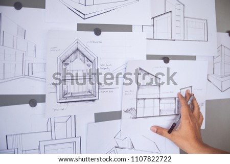 Architect Designer Engineer sketching drawing draft working Perspective Sketch  design development process house construction Project #1107822722