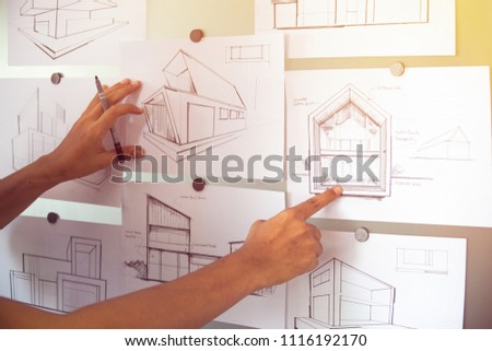 Architect Designer Engineer sketching drawing draft working Perspective Sketch  design house construction Project #1116192170