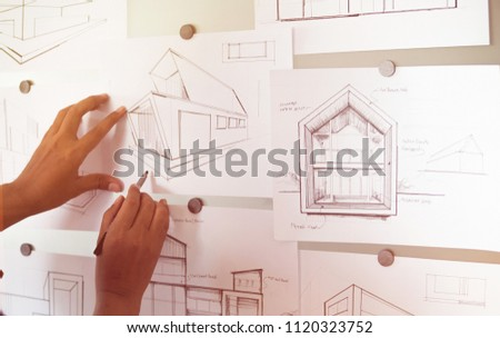 Architect Designer Engineer sketching drawing draft working Perspective Sketch  design house construction Project #1120323752