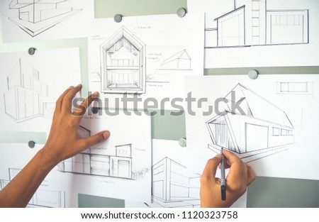 Architect Designer Engineer sketching drawing draft working Perspective Sketch  design house construction Project #1120323758