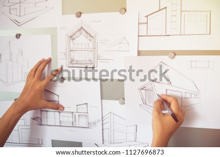 Architect Designer Engineer sketching drawing draft working Perspective Sketch  design house construction Project #1127696873