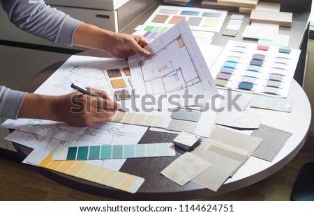 Architect designer Interior creative working hand drawing sketch plan blue print selection material color samples art tools Design Studio #1144624751