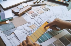 Architect designer Interior creative working hand drawing sketch plan blueprint selection material color samples art tools Design Studio