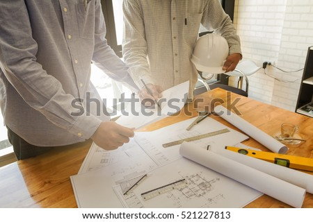 Architect discuss with engineer about project in office, architectural concept #521227813