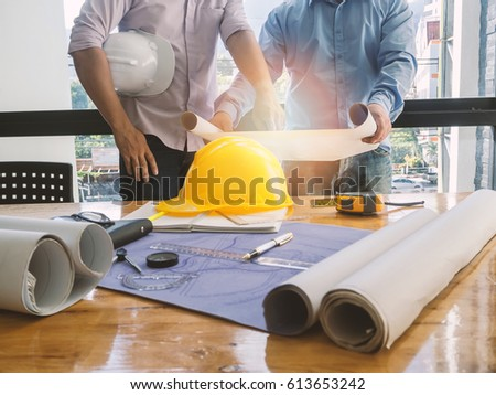 Architect discuss with engineer about project in office, architectural concept #613653242