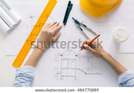 Architect drawing blueprints, architectural project in progress. Construction engineering
