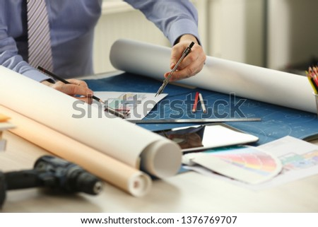 Architect Drawing Building Reconstruction Sketch. House Designing Concept. Professional Engineer Sketching Blueprint Using Engineering Measuring Equipment, Compass. Architector Desk Closeup #1376769707
