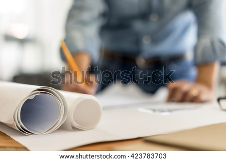 architect drawing on blueprint architectural concept, soft focus
