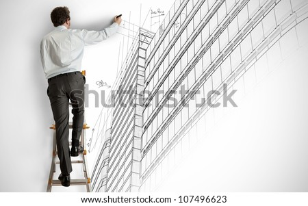 Architect draws a project on a staircase