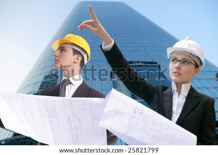 Architect executive business people with plans, hard hat [Photo Illustration]